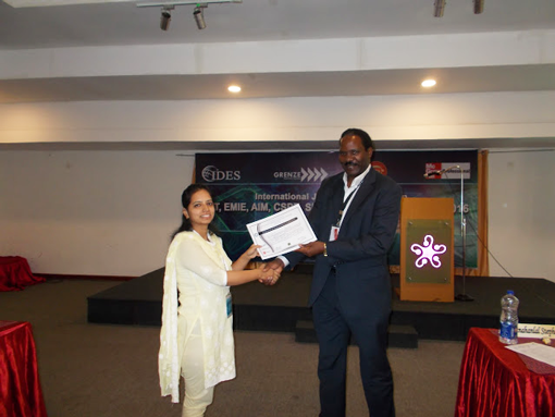 Ms.Pooja Pandey receiving-certificate-from-Dr.-Robert-Balagadde